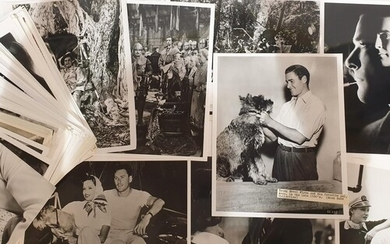 A collection of Errol Flynn publicity and film stills to inc...