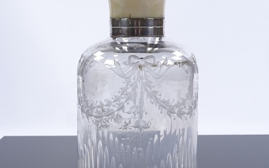 A cut-glass perfume bottle with ivory-mounted silver screw t...