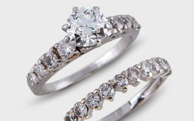 A diamond and platinum engagement ring and wedding band...