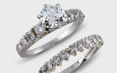 A diamond and platinum engagement ring and wedding