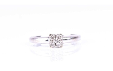 A five stone diamond cluster ring, the round brilliant cut d...