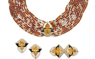 A gem-set necklace, earring and brooch suite