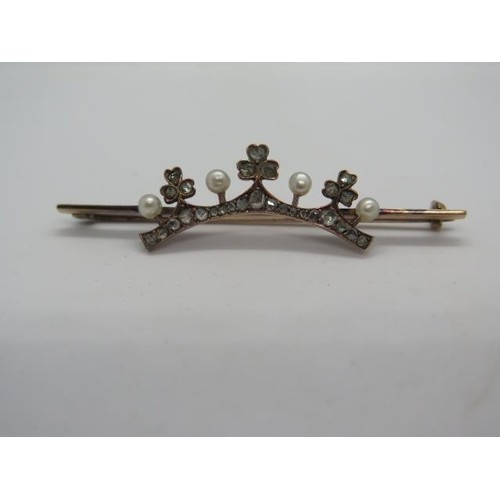 A gold diamond and pearl tiara shape brooch set with twenty-...