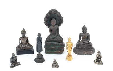 A group of eight various copper-alloy and yellow metal figures of Buddha