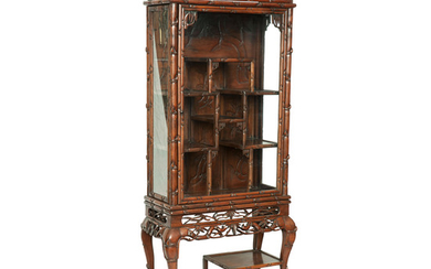 A hongmu faux-bamboo tall display cabinet on stand
