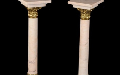 A pair of Continental mottled pink marble and gilt bronze mounted columns