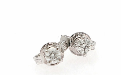 A pair of diamond solitaire ear studs each set with a brilliant-cut diamond totalling app. 0.49 ct., mounted in 18k white gold. L/SI. (2)