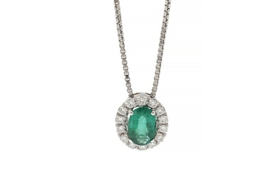 A pendant set with an oval-cut emerald weighing app. 0.57 ct. encircled by numerous diamonds, mounted in 18k white gold. Accompanied by chain of 18k white gold.