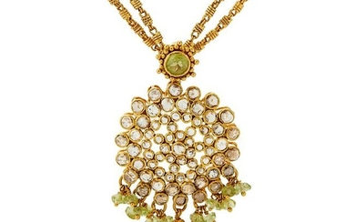 A peridot and diamond pendant necklace.