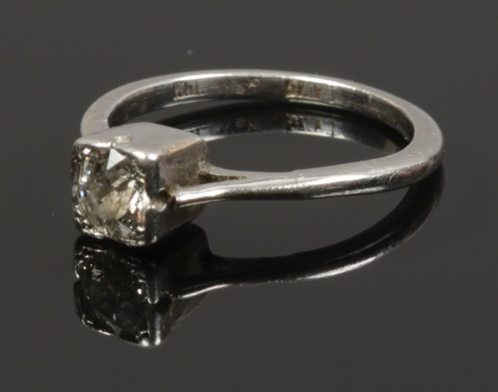 A platinum and diamond solitaire ring, size F, approximately...