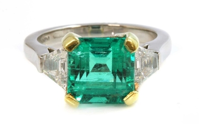 A platinum and gold Colombian emerald and diamond three stone ring