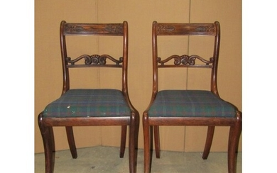 A set of seven Regency rosewood bar back dining chairs with ...
