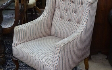 A small Victorian button-back upholstered armchair on cabrio...