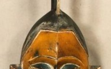 "AFRICAN CARVED WOOD MASK, 20TH C, W 8.5"" L 30"""