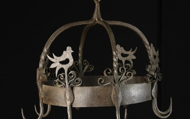 An 18th Century Style Wrought Iron Game Hanger with eight hooks attached to a circular hoop surmount