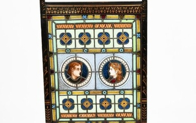 An Aesthetic Movement stained glass and ebonised wood fire screen in the style of Dr Christopher Dresser, the frame with stencilled geometric flower motif in gilt, the glass with roundel portrait panels, amongst geometric borders, unsigned, 118cm. high...