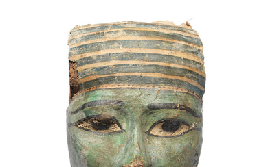 An Egyptian gesso-painted wood mummy mask