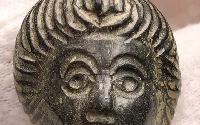 Ancient Roman Bronze Impressive Decorative Mask of Youth with an interesting Hairstyle.