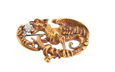 Brooch in 18 K (750 °/°°°) yellow gold representing a chimera fighting against a snake around an old cut diamond on either side of their gules; the pin brought back in silver plated metal Gross