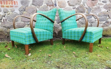 Danish furniture design: A pair of Art Deco easy chairs with stained wood armrests and legs, upholstered with checkered fabric. 1930–40s. (2)