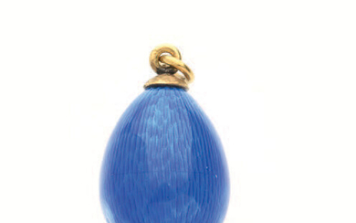 Egg-shaped pendant in yellow gold enamelled royal blue...
