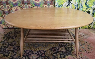 Ercol light elm circular coffee table with spindled under-ti...