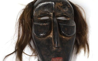 "False Mask"" mask made of wood with black patina and red pigment, hair made of horsehair."