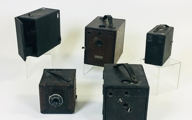 """Five Falling Plate Cameras, two """"Magazine Cyclone """" 4 x 5 cameras: No. 3 and No. 5; and three unmarked cameras."""