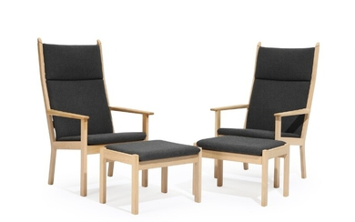 """NOT SOLD. Hans J. Wegner: """"GE 284A"""". A pair of oak high-backed easy chairs with..."""