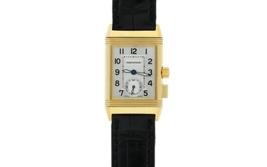 JAEGER-LECOULTRE | REF 255.1.82 REVERSO MEMORY, A YELLOW GOLD RECTANGULAR REVERSIBLE WRISTWATCH WITH FLY BACK 60-MINUTE COUNTER CIRCA 2000