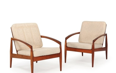 Kai Kristiansen: A pair of easy chairs of rosewood. Cushions in seat and back upholstered with light flecked wool. Manufactured by Magnus Olesen. (2)