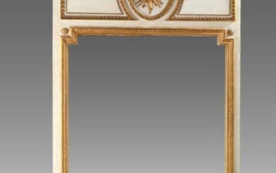 Large overmantel in grey and gold lacquered wood framing a mirror carved with a basket of flowers in a medallion at the top.