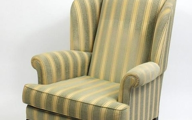 Mahogany framed wingback armchair with green and gold