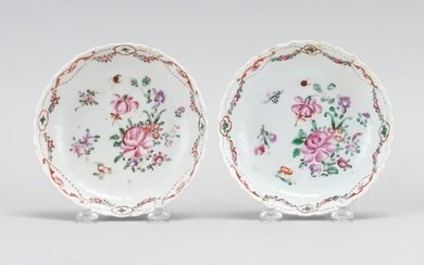 PAIR OF CHINESE FAMILLE ROSE PORCELAIN SAUCERS With slightly fluted exteriors, scalloped edges, floral sprays at center, and a swag...