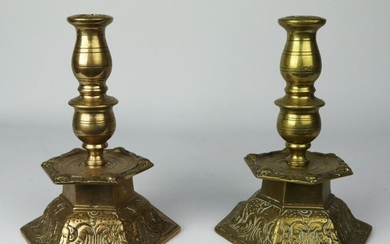 Pair of candleholders in cast and chased brass, alternating base of rinceaux