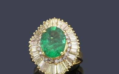 Ring with oval cut emerald.