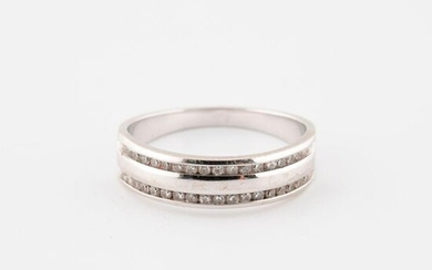White gold wedding band (585) set with two lines of small eight-cut diamonds in rail-set.