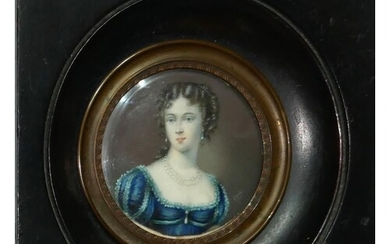 A 19TH CENTURY CIRCULAR MINIATURE PORTRAIT OF A YOUNG LADY W...