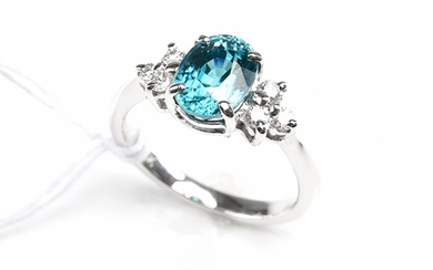 A BLUE ZIRCON AND DIAMOND DRESS RING, CENTRALLY SET WITH AN OVAL CUT BLUE ZIRCON WEIGHING 3.18CTS, IN 18CT WHITE GOLD, SIZE M, 4GMS