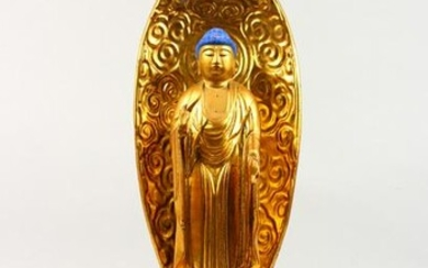 A CARVED GILTWOOD BUDDHA, with blue hair, on a throne.