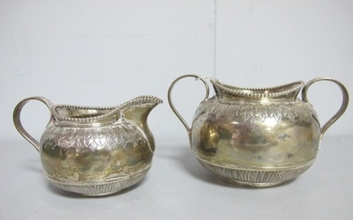 A Decorative Victorian Hallmarked Silver Jug and Twin handle...