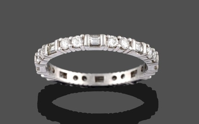 A Diamond Eternity Ring, pairs of round brilliant cut diamonds...