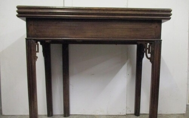 A George III Chippendale style mahogany tea/card table with ...