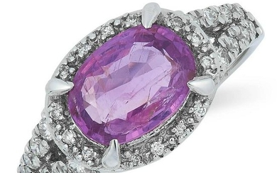 A PINK SAPPHIRE AND DIAMOND RING set with an oval cut