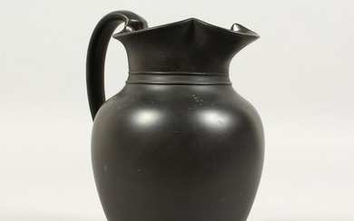 A PLAIN WEDGWOOD BLACK BASALT WATER JUG. Impressed
