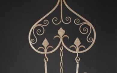 A Pair of 17th Century Style Trammel hooks hanging from a decorative wrought iron rack ornamented wi