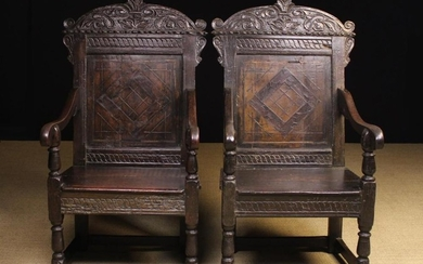 A Pair of Early 17th Century & Later Inlaid Oak Wainscot Chairs. The shaped top rails carved with fo