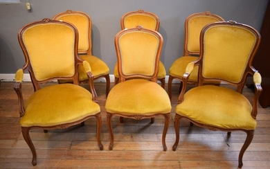 A SET OF SIX FRENCH STYLE DINING CHAIRS INCLUDING TWO CARVERS, IN GOLD UPHOLSTERY