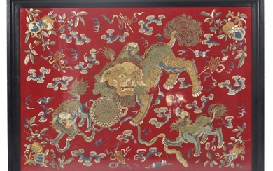 A SILK EMBROIDERY DEPICTING LIONS CHASING A BALL, China, late 19th ct. - Couched metal-wrapped threads and floss silk embroidery on red ground - 66 x 90 cm, R.