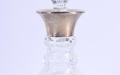 A SILVER MOUNTED GLASS DECANTER. 28 cm high.